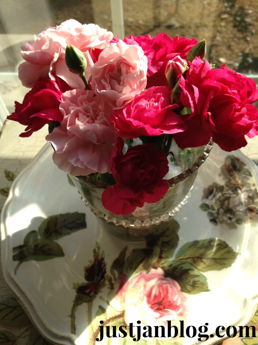 Roses in mercury glass on rosey dish
