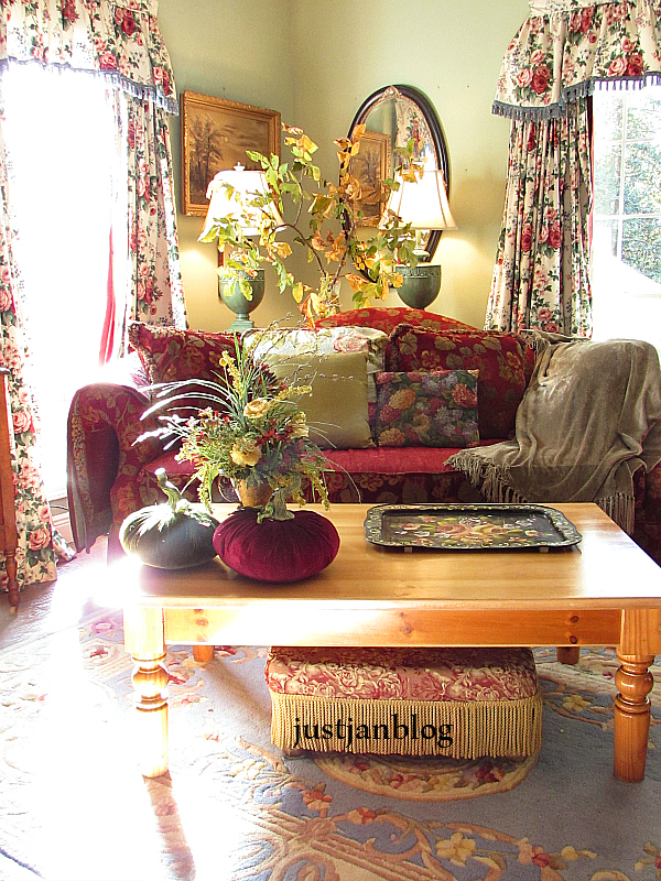 The Fall Floral With Yellow Roses Are Sitting Velvet Pumpkins On Coffee Table Give Solid Clues