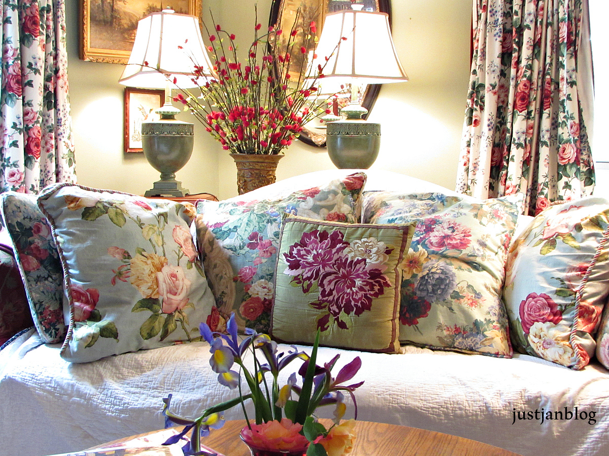 sofa with floral pillows